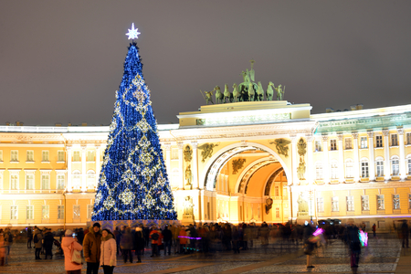 ST.PETERSBURG, RUSSIA - 5 JANUARY 2018: Christmas tree on Palace Square in St.Petersburg at night. Arch of the General Staff in the background.