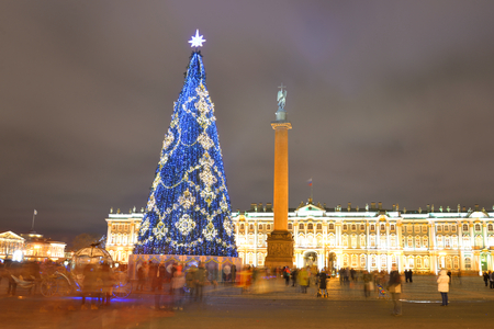 ST.PETERSBURG, RUSSIA - 5 JANUARY 2018: Christmas tree on Palace Square in St.Petersburg at night. Winter Palace in the background.