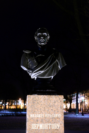 ST.PETERSBURG, RUSSIA -16 JANUARY 2018: Monument to the writer Lermontov in Alexander Garden at night in Saint Petersburg, Russia.