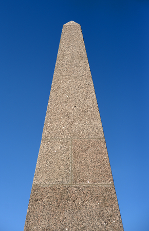 Granite stele on blue sky background on the outskirts of St. Petersburg, Russia. Monument to Russian soldiers took part in the Russian-Swedish war of 1788-1790. Editorial