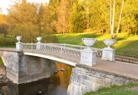 Cast-iron bridge in Pavlovsk Park at sunny spring evening, near St.Petersburg, Russia.