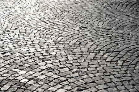 Cobblestone sidewalk made of small stones at sunny day. Stock fotó - 102741312