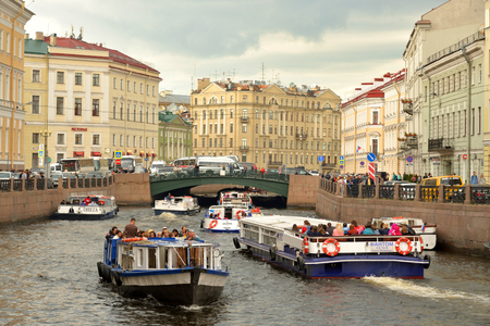 ST.PETERSBURG, RUSSIA - 12 JUNE 2018: Pleasure boats on the Moika River in the center of St. Petersburg.
