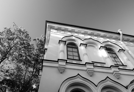 Fragment of cell building of Resurrection Novodevichy Monastery in St.Petersburg at evening, Russia. Black and white.