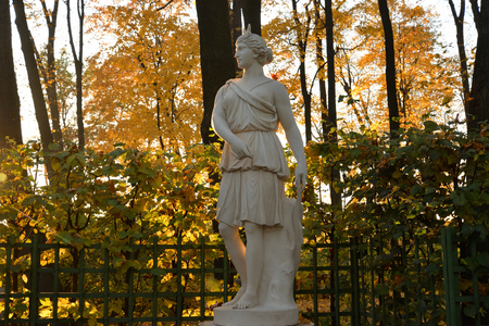 Goddess Diana statue in Summer Garden at autumn evening, St.Petersburg, Russia. In Roman mythology, the goddess of flora and fauna, hunting, femininity and fertility.