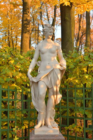 Thalia statue, comedy muse in Summer Garden at autumn evening, St.Petersburg, Russia. Thalia - in Greek mythology, the muse of comedy and light poetry.