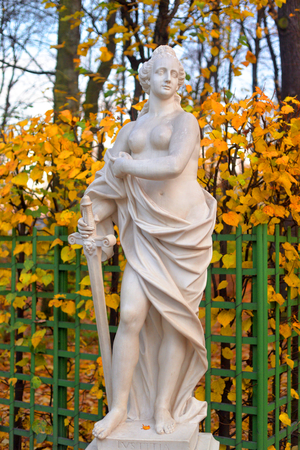 Statue of allegory of justice in Summer Garden at autumn evening, St.Petersburg, Russia.