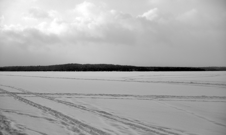 Frozen lake in the winter in Karelian isthmus, Russia. Black and white. Standard-Bild
