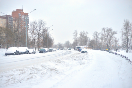 Snow-covered street on the outskirts of St. Petersburg at cloud winter day, Russia. 写真素材