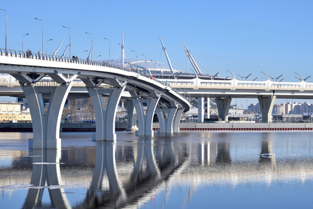 New pedestrian Yacht Bridge in St.Petersburg at sunny spring day, Russia.