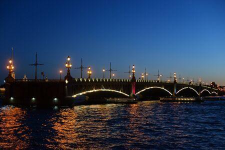 Trinity bridge and Neva River at night in St.Petersburg, Russia. Archivio Fotografico