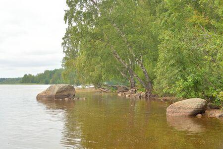 Coast of lake at cloud day in Karelian Isthmus, Leningrad region, Russia.