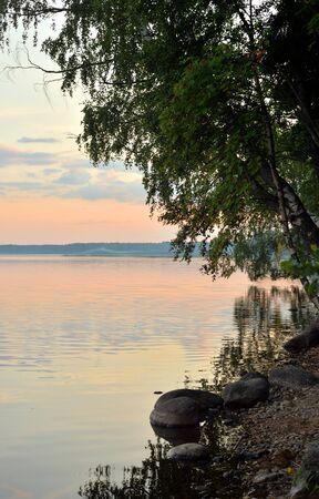 Coast of lake at summer evening in Karelian Isthmus, Leningrad region, Russia.