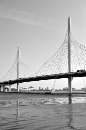 Cable bridge across the Petrovsky fairway of Neva River in Saint Petersburg, Russia. Part of the Western high-speed diameter. Black and white.