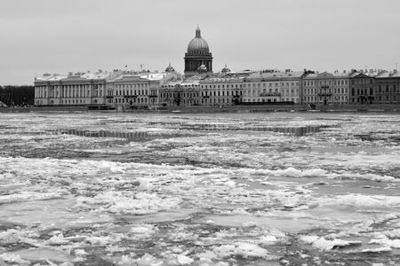 English embankment and Neva river in St.Petersburg at winter day, Russia. Black and white.