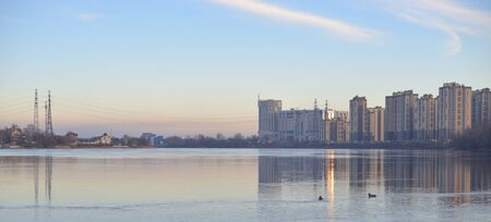 View of Neva River and modern residential buildings on the outskirts of St. Petersburg, Russia.