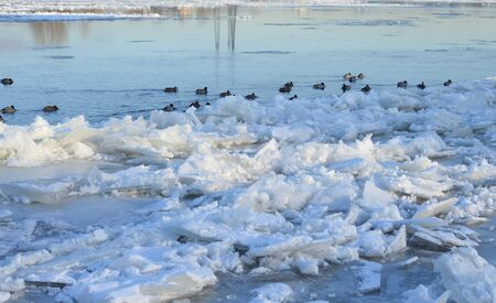 Ice floes on the river at winter day, Russia.