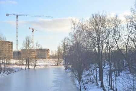 View of the river Slavyanka on the outskirts of St. Petersburg at winter day, Russia.