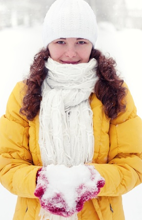 Woman with snow in winter Stock Photo