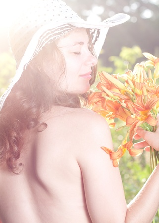 Beautiful female with flowers  Shining summer day Stock Photo