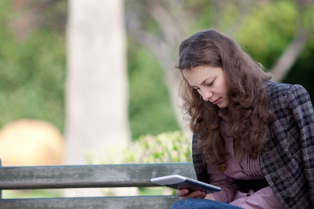 woman reading digital book at the park Stock Photo - 13216948