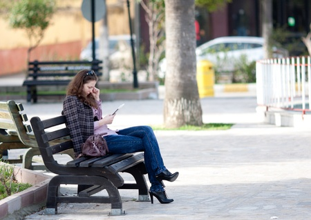 woman reading digital book at the park Stock Photo - 13216947