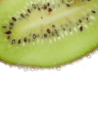 segment of kiwi isolated on white with bulbes of water Stock Photo