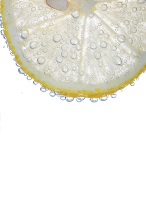 segment of lemon isolated on white with bulbes of water