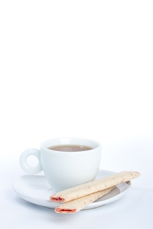 Cup of tea with cookie closeup isolated on white Stock Photo