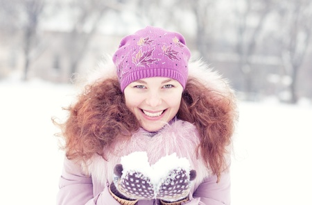 Woman play with snow in winter Stock Photo
