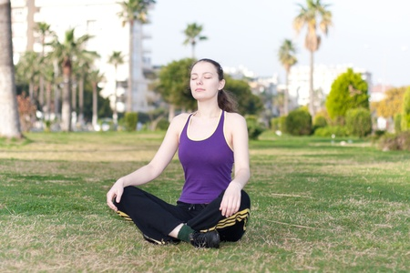 Woman in sports wear doing relaxing excercises
