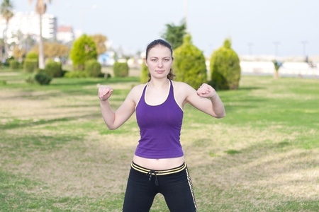 Athletic woman stretches before a run Stock Photo