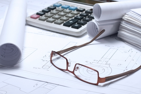Rolled Blueprints, glasses and ruler on architects worktable photo