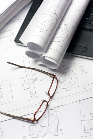 Rolled Blueprint, glasses and ruler on architects worktable photo