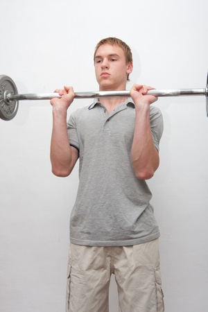 Man with a bar weights in hands training  photo