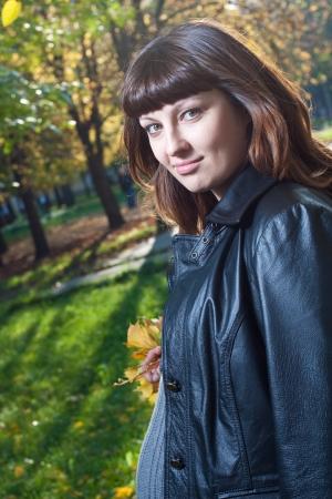 Pleasured pregnant woman in autumn park  photo