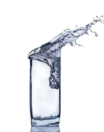 Glass of water isolated on white. Image toned in blue.