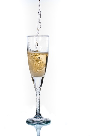 Glass of champagne on white background  Flow of champange from the top