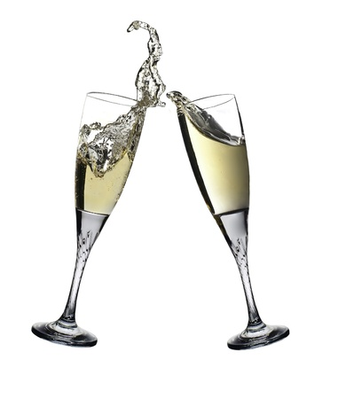 Pair of champagne flutes making a toast  Champagne splash