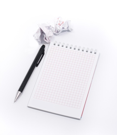 Isolated pen on the note pad. Rumple paper around photo