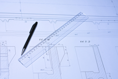 Pencil and ruler on the open blueprint photo