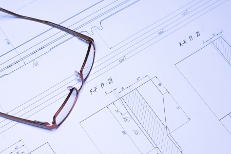 Glasses and calculator laying on the blueprint architects glasses laying on the blueprint architect photo malvernweather Image collections