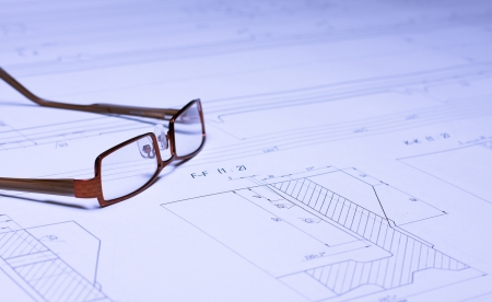 Glasses laying on the blueprint  Architect photo