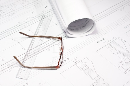 Rolled Blueprint, glasses and ruler on architect photo