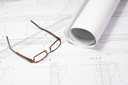 Glasses laying on the blueprint  Architect photo