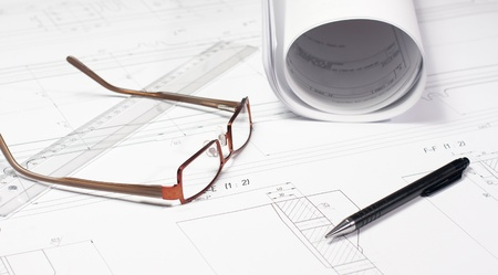 Glasses laying on the blueprint  Architect