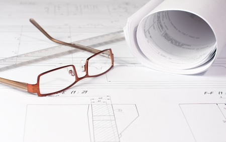 Rolled Blueprints, glasses and ruler on architect photo