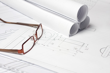 Rolled Blueprint and glasses on architect photo