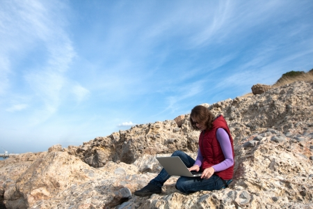 Woman working on the laptop outdoor Stock Photo - 17544096