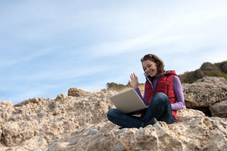Young woman working on a rock with her laptop Stock Photo - 17544094